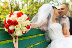 Bouquet of flowers with blurred newlyweds Royalty Free Stock Images