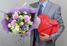Bouquet of flowers and box of chocolates Royalty Free Stock Photo