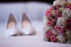 Bouquet of flowers and bridal shoes royalty free stock photos