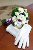Bouquet of flowers for the bride at the wedding, and white glo Royalty Free Stock Images