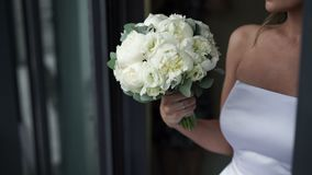 Bouquet flowers in brides hands stock footage