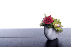 Bouquet of flowers on a brown desk with isolated background Stock Photography