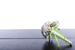 Bouquet of flowers on a brown desk with isolated background Royalty Free Stock Photography