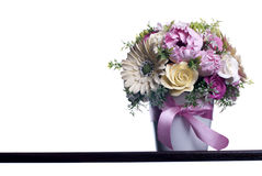 Bouquet of flowers on a brown desk with isolated background Royalty Free Stock Images