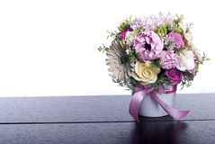 Bouquet of flowers on a brown desk with isolated background Royalty Free Stock Image