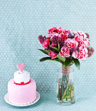 Bouquet of flowers and cake. With red hearts Stock Images