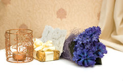 Bouquet of flowers and candle. Gift, blue hyacinths, candle and valentine handmade card stock photography
