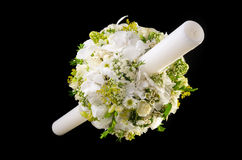Bouquet of flowers with candles for a special event. On dark background Stock Images
