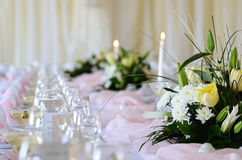 Bouquet of flowers with candles to set table Stock Images