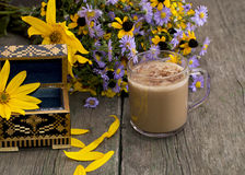 Bouquet of flowers, cappuccino, casket and petals Royalty Free Stock Photography