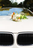 Bouquet of flowers on car hood royalty free stock photography