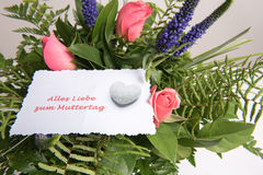 Bouquet of Flowers with card alles Liebe in german Stock Photo