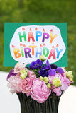 Bouquet of flowers and card Happy birthday Royalty Free Stock Photos