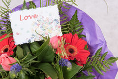 Bouquet of Flowers with card Love Royalty Free Stock Image