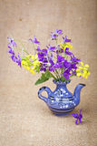Bouquet of flowers in a ceramic teapot Stock Image