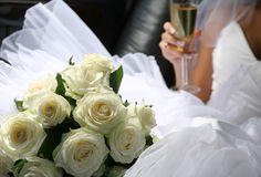 Bouquet of flowers and champagne Royalty Free Stock Photos
