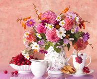 Bouquet of flowers and cup stock photography