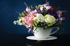 Bouquet of flowers. In a cup Stock Images