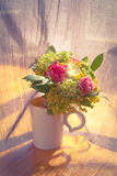Bouquet of flowers in a cup Royalty Free Stock Photography