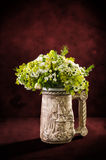Bouquet of flowers in a decorative vase Stock Image