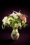 Bouquet of flowers in a decorative vase Stock Images