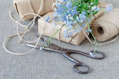 A bouquet of flowers forget-me-nots with gift Royalty Free Stock Photos