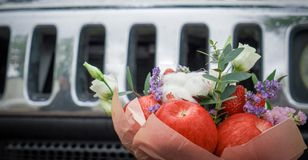 Bouquet from flowers and fruit royalty free stock photography