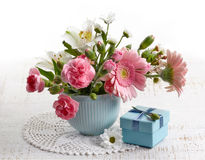 Bouquet of flowers and gift box Stock Image