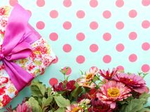 Bouquet of flowers and gift box with space copy background. Beautiful romantic gift box and artificial flower bouquet Royalty Free Stock Photography