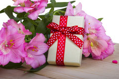 Bouquet of flowers with gift box on a wood Stock Photos