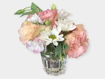 A bouquet of flowers in a glass cup on white. royalty free stock image