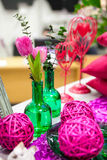 Bouquet flowers in glass vase. Arrangement of green glass vases and flowers Royalty Free Stock Photography