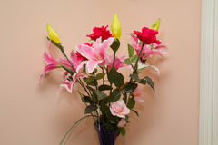 Bouquet of flowers in glass vase Stock Photos