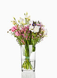 Bouquet of flowers in a glass vase. On white background Stock Photo