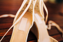 Bouquet of flowers and greenery and shoes bride Royalty Free Stock Photos