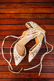 Bouquet of flowers and greenery and shoes bride Stock Photos