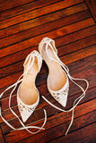 Bouquet of flowers and greenery and shoes bride Royalty Free Stock Images