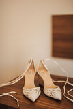Bouquet of flowers and greenery and shoes bride Royalty Free Stock Photography