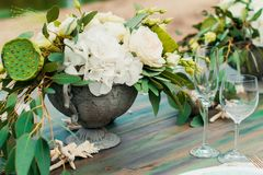 Bouquet of flowers and greenery is on the wedding table royalty free stock photo