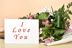 Flowers and greeting card with I Love You message stock photos
