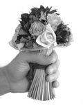 Bouquet of flowers in hand. Hand holding a bouquet of flowers in black and white stock images