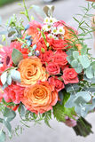Bouquet of flowers. Hand holding colorful bouquet of flowers Royalty Free Stock Images