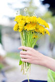 Bouquet of flowers in hand Royalty Free Stock Photography