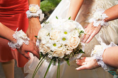 Bouquet of flowers and hands Royalty Free Stock Photography