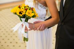 Bouquet of flowers in the hands of the bride royalty free stock photo