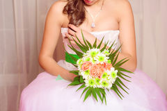 Bouquet of flowers in the hands of a young bride Royalty Free Stock Images
