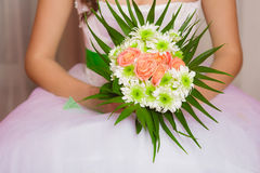 Bouquet of flowers in the hands of a young bride Stock Photo