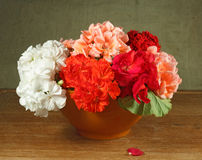 Bouquet of flowers home on a wooden table Royalty Free Stock Photo