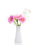 Bouquet of flowers isolated on white background. Bunch of gerbera daisies pink flowers in a white vase on white background stock photos