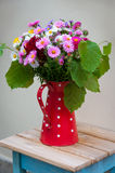 Bouquet of flowers in a jug. Stock Photography